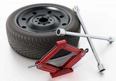 motorist-changing-flat-tire-9